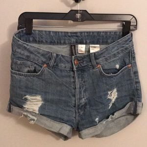 Blue jean shorts with distressing